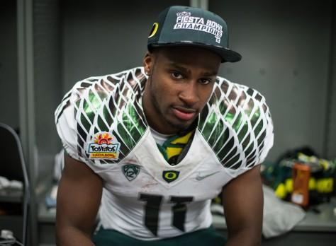 Wide receiver Bralon Addison pauses in the Oregon locker room after the Ducks' Fiesta Bowl victory. (Michael Arellano/Emerald)