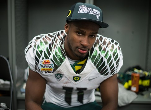 Wide receiver Bralon Addison pauses in the Oregon locker room after the Ducks' Fiesta Bowl victory. (Michael Arellano/Emerald)
