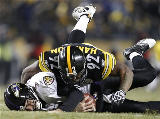 Pittsburgh Steelers linebacker James Harrison (92) sacks Baltimore Ravens quarterback Joe Flacco (5) during the second half of an NFL divisional football game in Pittsburgh, Saturday, Jan. 15, 2011. (AP Photo/Gene J. Puskar)